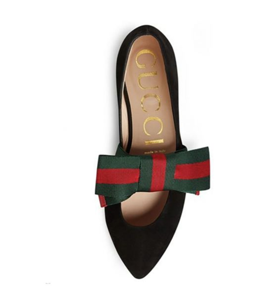 4936579b72b Gucci s take on the ballet flat features a point toe and an oversized bow  made with the classic Gucci stripe. A perfect fall flat. So Suzy Says.